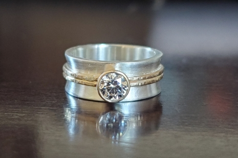 Sterling silver 14k yellow gold ring 8mm wide 5.5mm Moissanite Charles and Colva