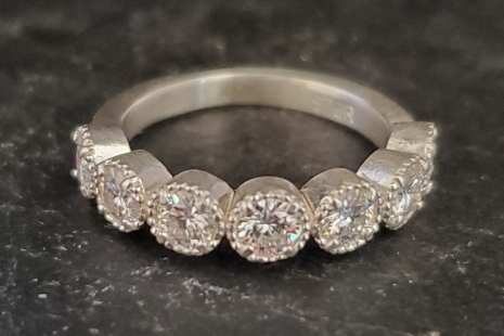 Seven stone moissanite and sterling silver tarnish resistant silver ring stateme