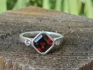 Asscher Cut Deep Red Garnet Bezel Set in Sterling Silver, White Sapphire Accents